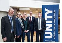 Stipendiat lernt sein Förderunternehmen UNITY kennen